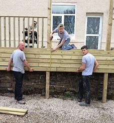 Amanda Wrigley and her team putting in some decking.